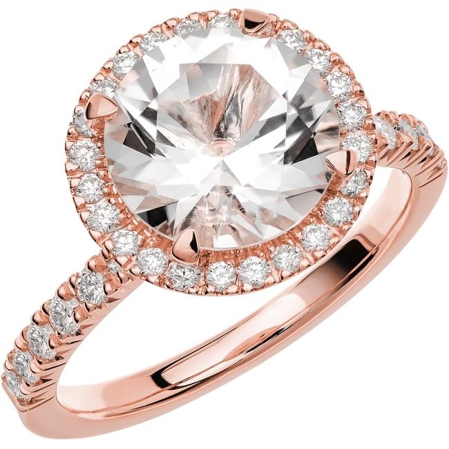 Ring i 18k roseguld med en briljantslipad Akvamarin sten 9,5 mm , 24st briljantslipade diamanter på 0,01 ct styck och 12st briljantslipade diamanter på 0,02 ct styck, totalt 0,48 ct Wesselton SI