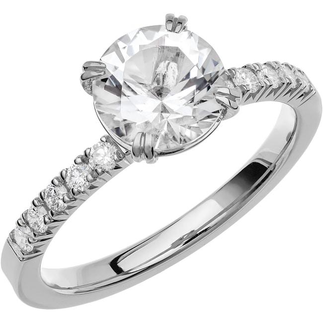 Schalins Ring i 18k vitguld med en briljantslipad Snövit Beryll sten, 7,5 mm och 10 st briljantslipade diamanter på 0,02 ct styck , totalt 0,20 ct WSI