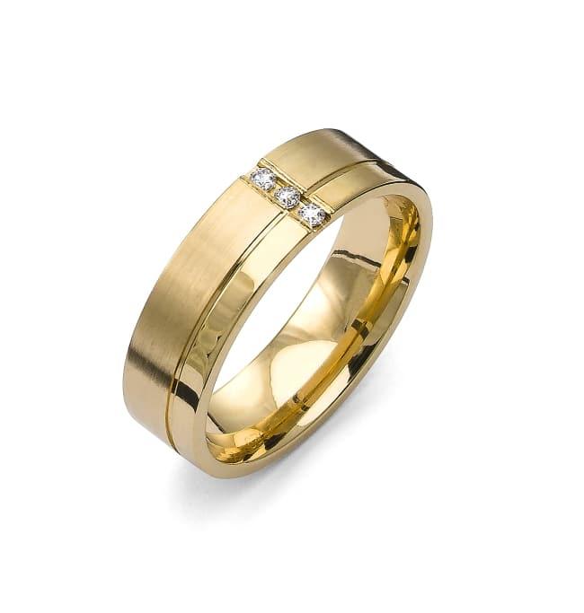 Förlovningsring från Flemming Uziel i 18k guld med 3st briljantslipade diamanter på 0,045 ct totalt Wesselton/SI