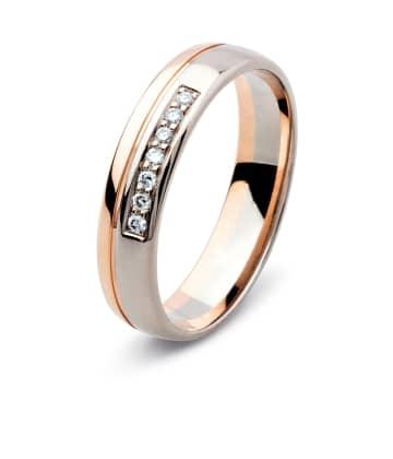 Vigselring från Flemming Uziel i 18k vitguld och roseguld med 7st briljantslipade diamanter på 0,01ct styck