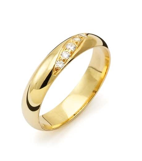 Vigselring från Flemming Uziel B008 18k guld med 5 diamanter på 0,007 ct. kvalite: WSI